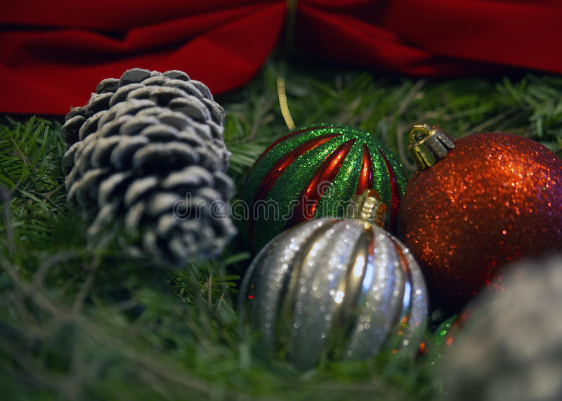 Ornaments with pine cone on wreath with bow stock images