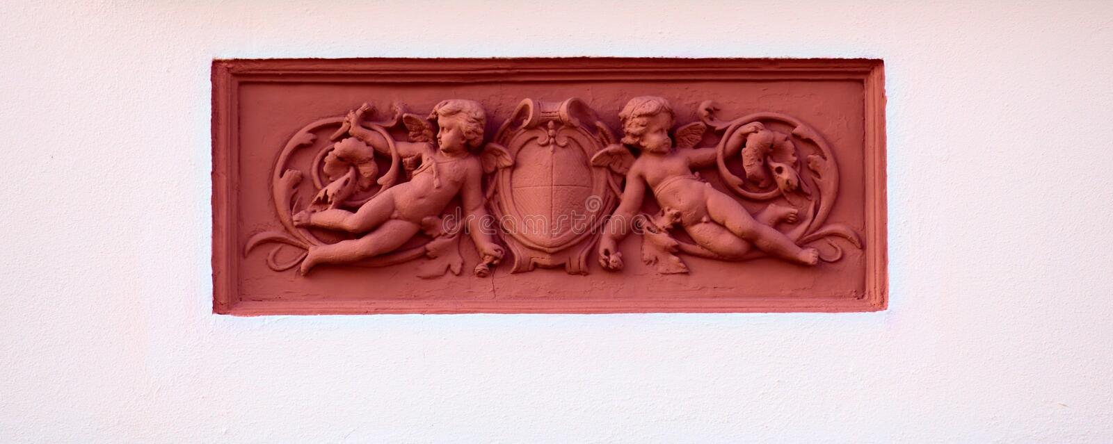 Ornaments with putti on a historic house from 1888 in Greifswald, Germany.  royalty free stock photo