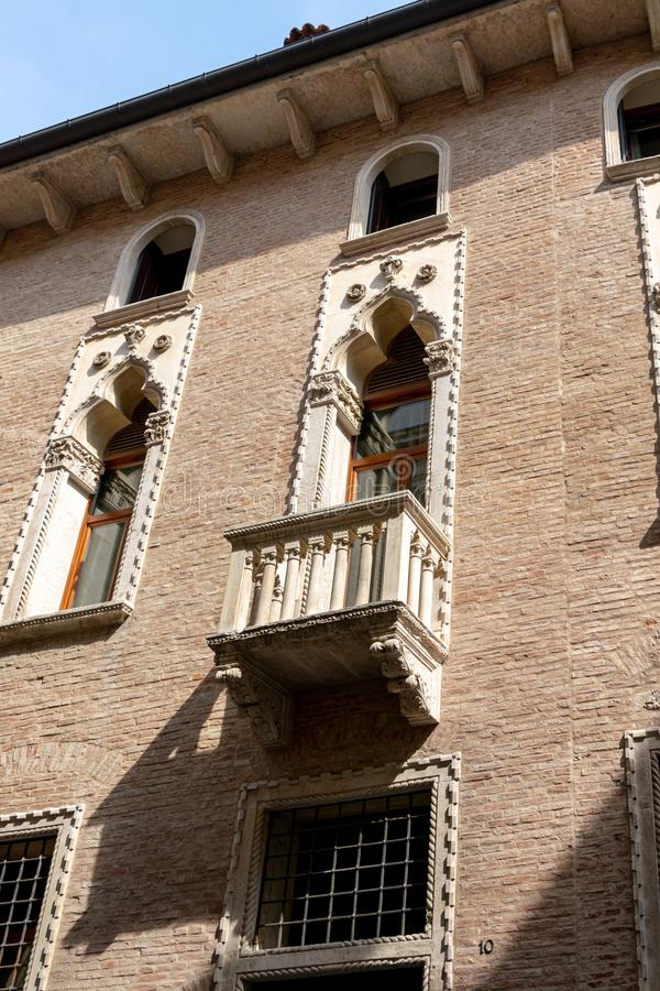 An ornate balcony on the facade of Palazzo Thiene on Contra Porti, Vicenza, Italy royalty free stock photos