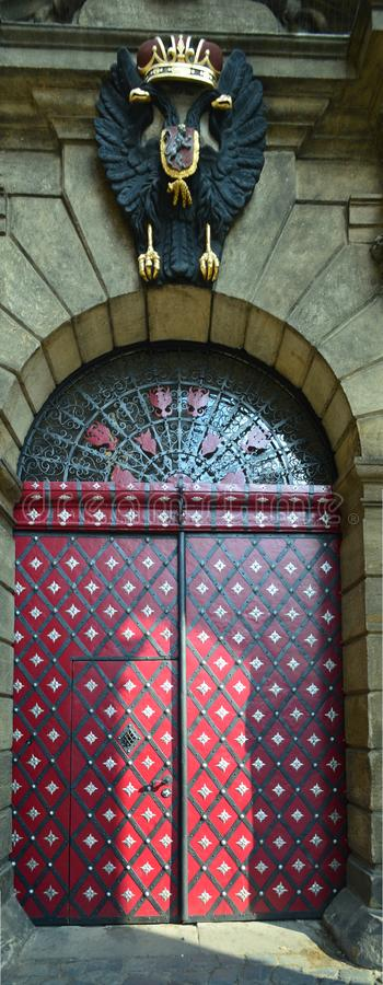 Big red door in prague czech republic. Ornate big red door at the Clementinum, Klementinum in Czech, is a historic complex of buildings in Prague. It is in use stock photo