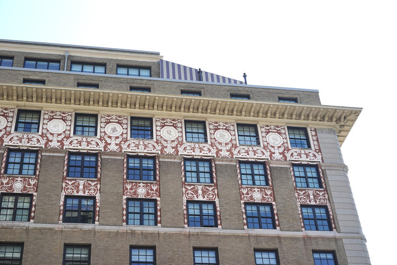 Ornate brickwork. The ornate brickwork design on the Washington Hotel in Washington, DC is highlighted by the neutral bricks of the building`s facade. This stock image