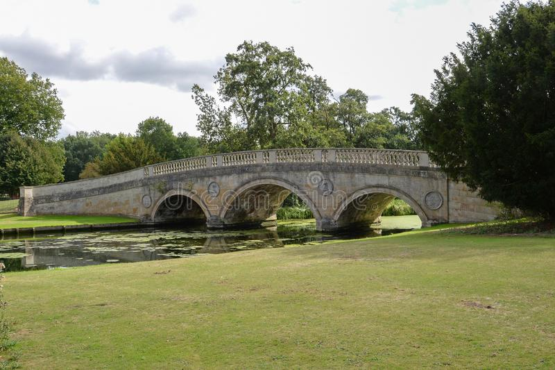 Ornate Bridge over the River Cam. The road which follows an old Roman Bridge and runs through the grounds of Audley End house in Cambridgeshire England stock image