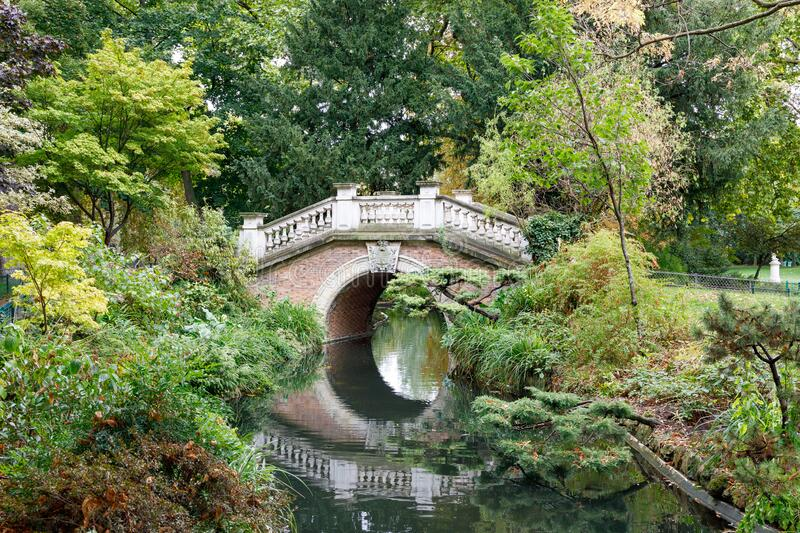 Bridge over water in Parc Monceau in Paris royalty free stock photo