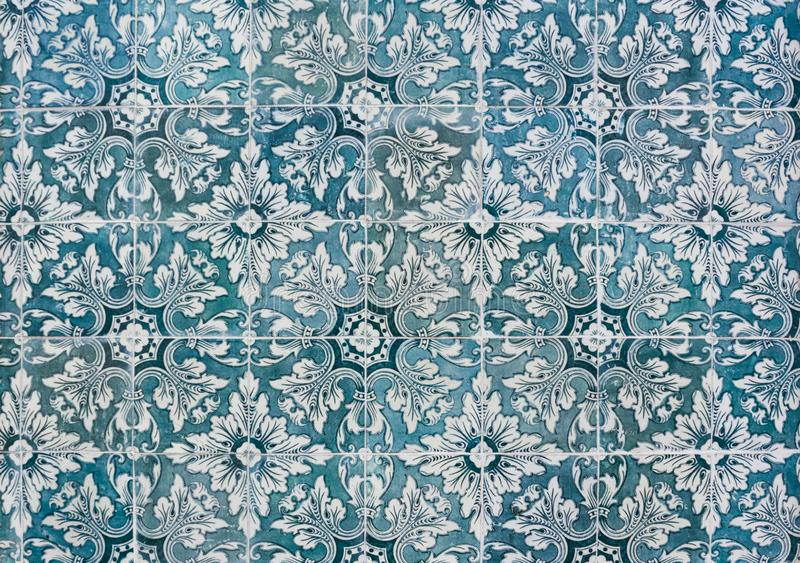 Ornate brightly colored Portugese tile texture in blue green and white stock photography