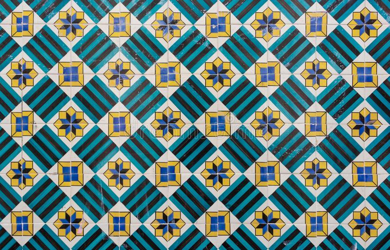 Ornate brightly colored portugese tile texture in blue, green and yellow. Star stripe and square patterned portugese tiles texture abstract antique art authentic royalty free stock images