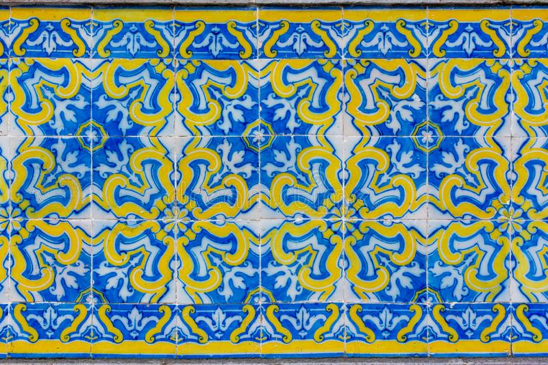 Ornate brightly colored Portugese tile texture in blue and yellow. Intricate floral patterned portugese tiles texture with boarder abstract antique art authentic stock photo