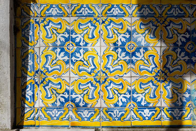 Ornate brightly colored Portugese tile texture in blue and yellow. Intricate floral patterned portugese tiles texture with boarder abstract antique art authentic royalty free stock images