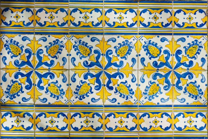 Ornate brightly colored Portugese tile texture in blue and yellow. Intricate floral patterned portugese tiles texture with boarder abstract antique art authentic royalty free stock photography