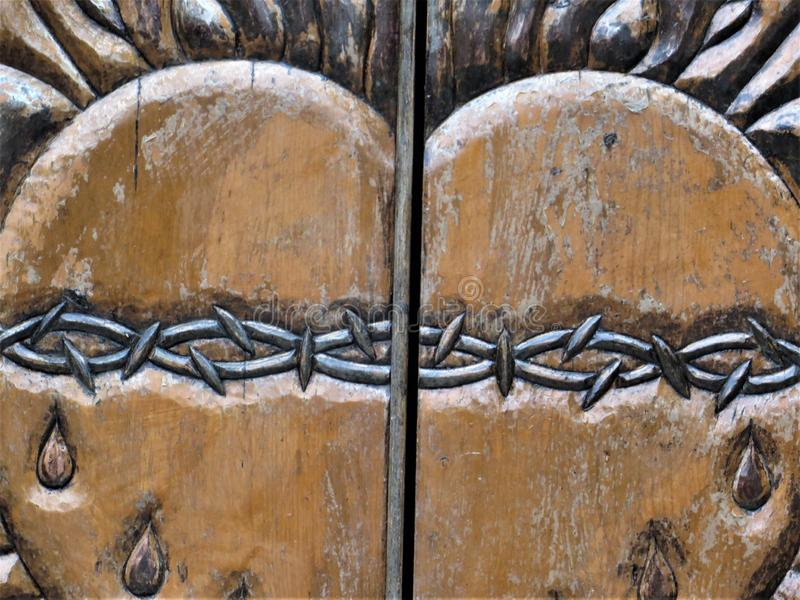 Detail of ornate carved doors, Chimayo, New Mexico royalty free stock photo