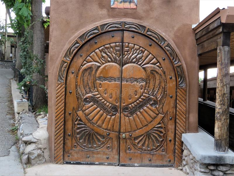 Ornate carved doors, Chimayo, New Mexico stock photos
