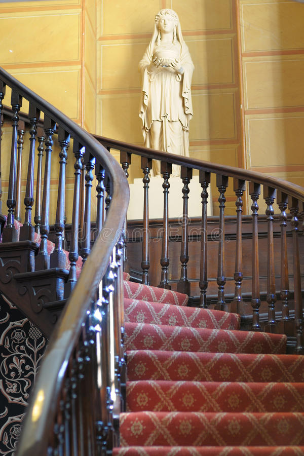 Ornate Circular Staircase. Old, ornate wooden circular staircase stock image
