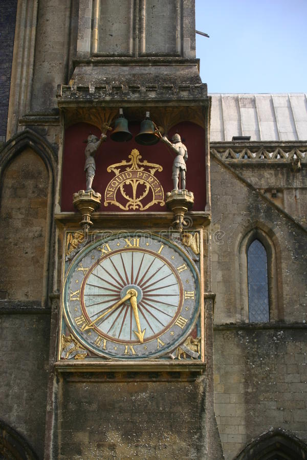 Ornate clock on Wells Cathedral. Clock features two moving figures in the shape of knights that strike bells stock images