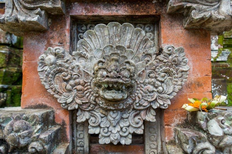 Ornate column in formal Balinese garden stock images
