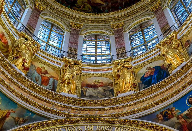 Ornate detail of the great dome and colorful icons in the Saint Isaac`s Russian Orthodox Cathedral in Saint Petersburg, Russia stock images