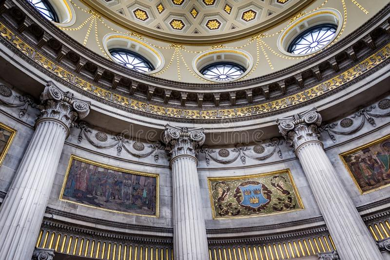 Ornate domed ceiling and columns with intricate patterns in the Rotunda of City Hall, Dublin, Ireland stock images