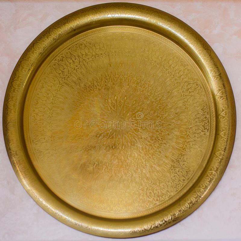 Ornate engraved brass wall plaque stock image