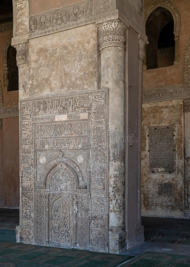Stone wall with engraved floral patterns and calligraphy in front of the foundation stone of Ahmed Ibn Tulun Mosque, Cairo, Egypt. Ornate engraved stone wall stock photos