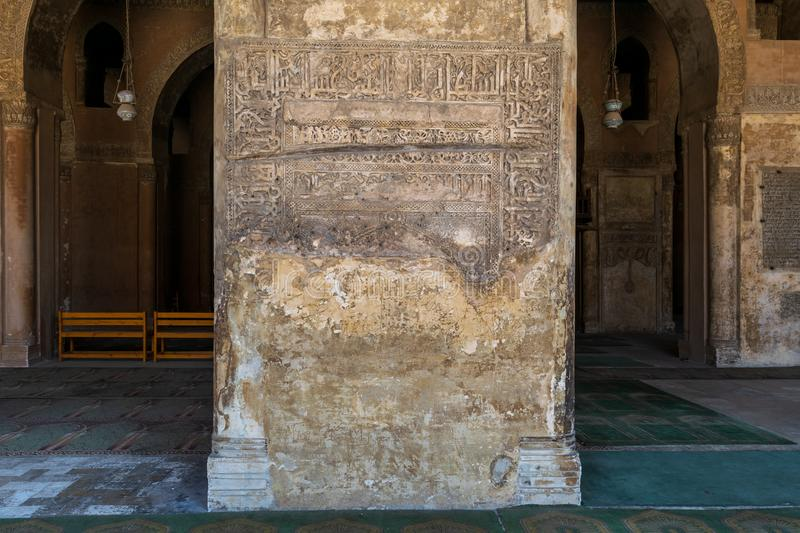 Ornate engraved stone wall with ruined floral patterns at Ibn Tulun Mosque, Cairo, Egypt. Ornate engraved stone wall with ruined floral patterns at Ahmed Ibn stock image