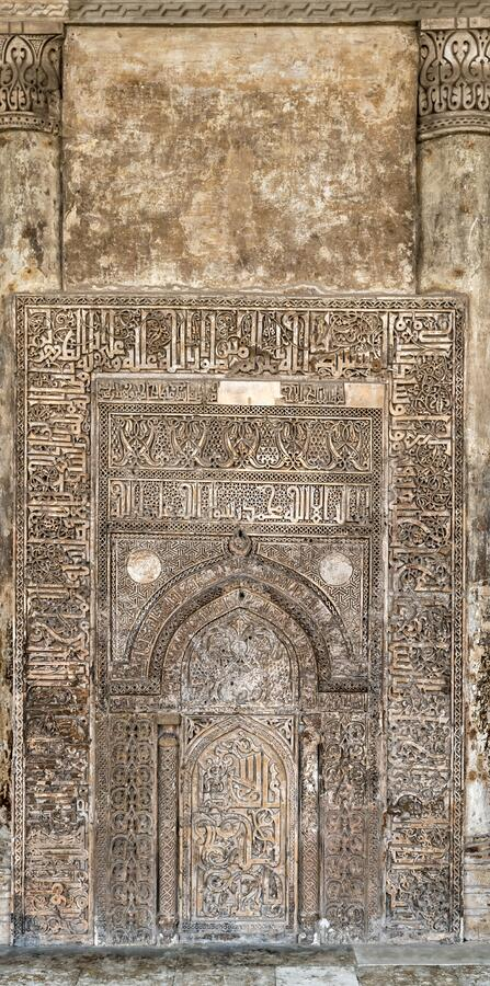 Ornate engraved stone wall with ruined floral patterns at Ibn Tulun Mosque, Cairo, Egypt. Ornate engraved stone wall with ruined floral patterns at Ahmed Ibn stock photo
