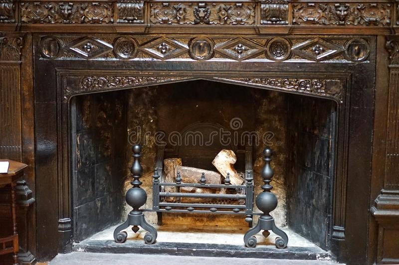 Intricate fireplace carvings in 18th century castle stock image