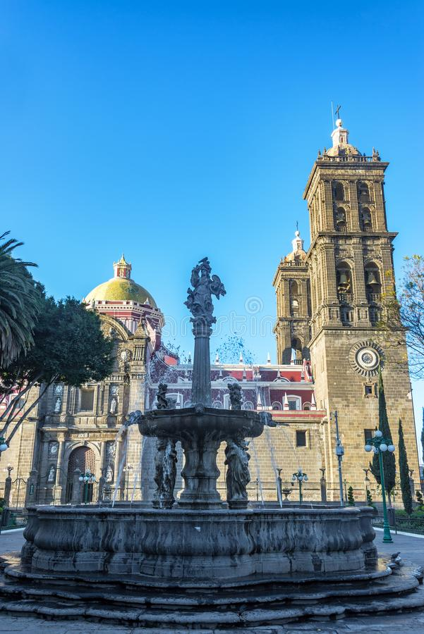 Ornate Fountain and Cathedral. Ornate fountain the Zocalo next to the cathedral in Puebla, Mexico stock photography