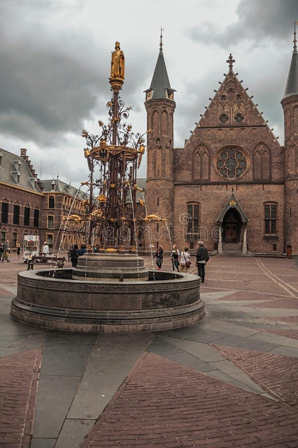 Ornate fountain in front of the gothic Ridderzaal great hall at The Hague. The Hague, western Netherlands - June 29, 2017. Ornate fountain in front of the stock photography