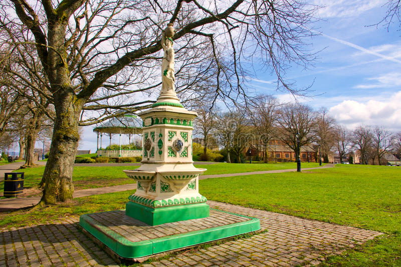 Ornate fountain. Fountain in park with bandstand in background royalty free stock photos