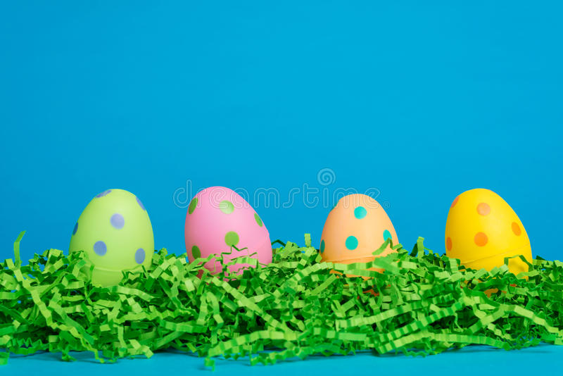Download 4 Assorted Decorated Easter Eggs On A Sky Blue Bac Stock Image - Image: 40104653