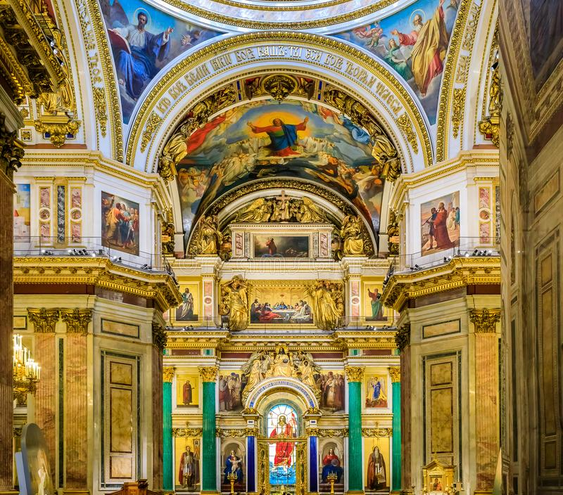 Ornate interior and icons of Jesus Christ, Mary and saints in Saint Isaac`s Russian Orthodox Cathedral in Saint Petersburg, Russi. Saint Petersburg, Russia stock photography