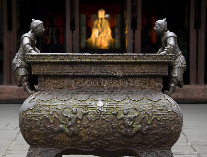 Ornate Iron Pot Liu Bei Statue. Closeup of ornate iron pot with Liu Bei statues, Wuhou Memorial, Three Kingdoms Temple, Chengdu, Sichuan, China stock photos