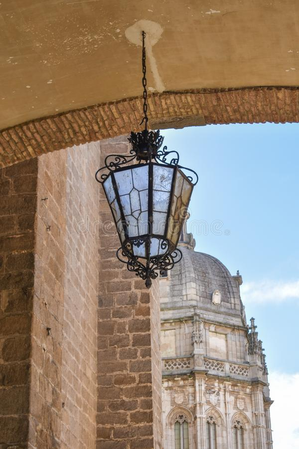 An ornate lamp hanging from a bridge stock photography