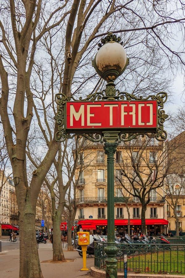 Ornate red art deco or art nouveau Parisian metro sign near La Tour Maubourg Merto stop by Les Invalides in Paris France royalty free stock image
