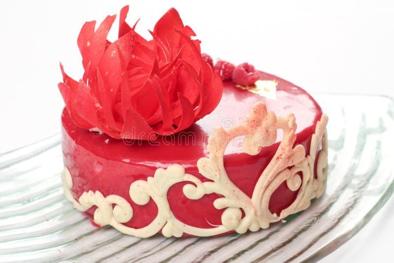 Ornate red velvet cake. Beautifully decorated red velvet cake royalty free stock images