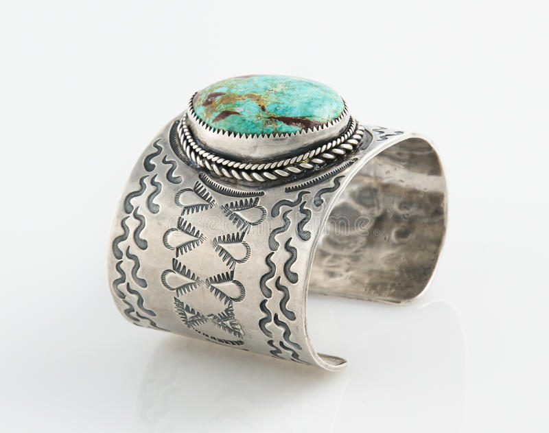Ornate Sterling Silver Cuff bracelet with large Turquoise Stone. Antique Native American Sterling Silver Cuff bracelet with large Turquoise Stone royalty free stock image