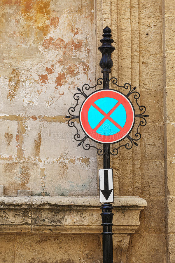 Ornate street sign. Prohibiting parking in Malta stock image
