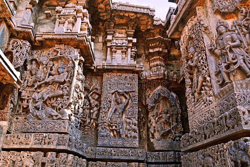 Ornate wall panel reliefs depicting Hindu deities, west side, Hoysaleshwara temple, Halebidu, Karnataka. India stock image
