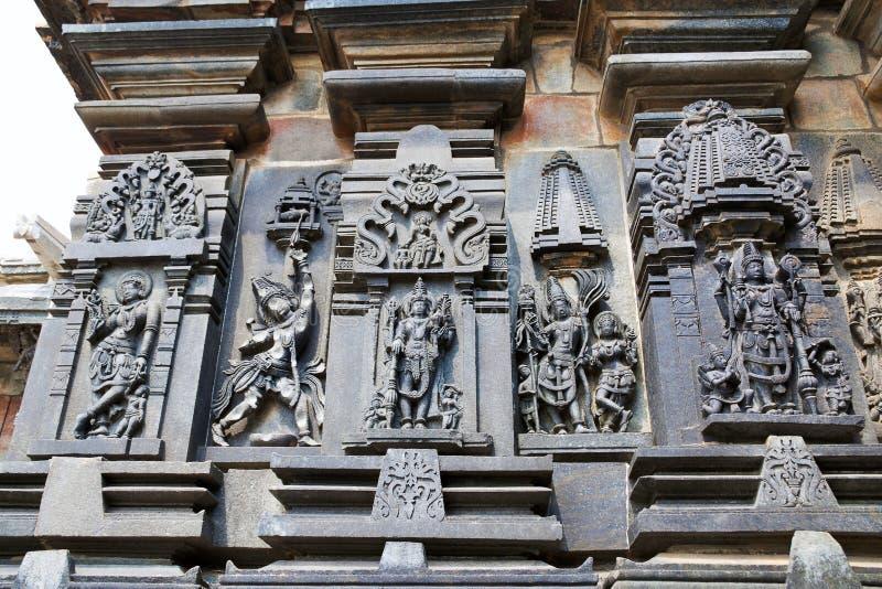 Ornate wall panel reliefs depicting, from left, Sundari, Arjuna shooting arrow, Lord Vishnu, Kamadeva and his consort Rati and Lor. D Vishnu, Chennakesava temple royalty free stock image