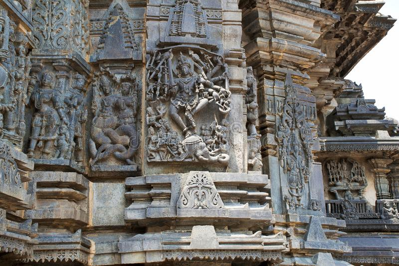 Ornate wall panel reliefs depicting, from left, Sundari, Nagas, Shiva as Gajasurasamhara, Bramha and Narayana on the extre right. Chennakesava temple, Belur royalty free stock image