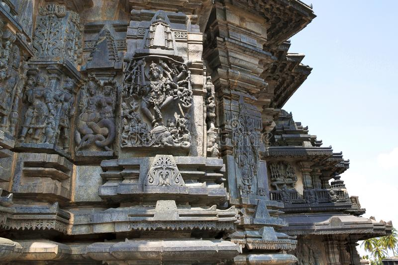 Ornate wall panel reliefs depicting, from left, Sundari, Nagas, Shiva as Gajasurasamhara, Bramha and Narayana on the extre right. Chennakesava temple, Belur stock image