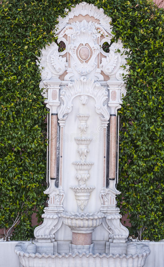 Ornate water fountain by a hedge. Ornate water fountain for washing outside a mosque in Istanbul Turkey stock photos