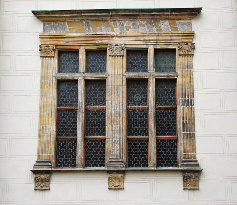 An ornate window in a white wall stock photos