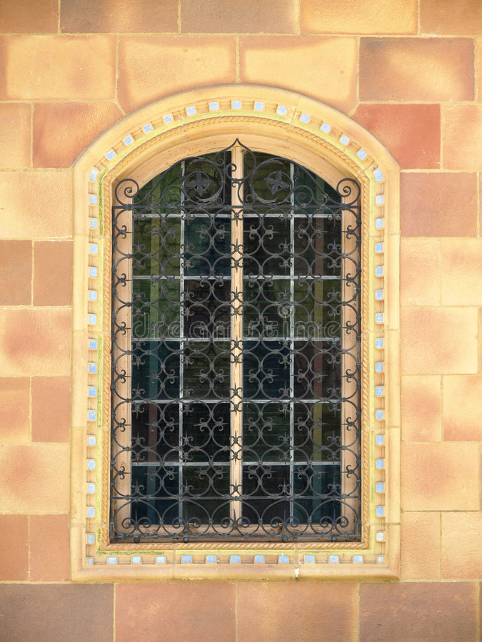 Free Ornate Window With Wrought Iron Bars Royalty Free Stock Photo - 5880335