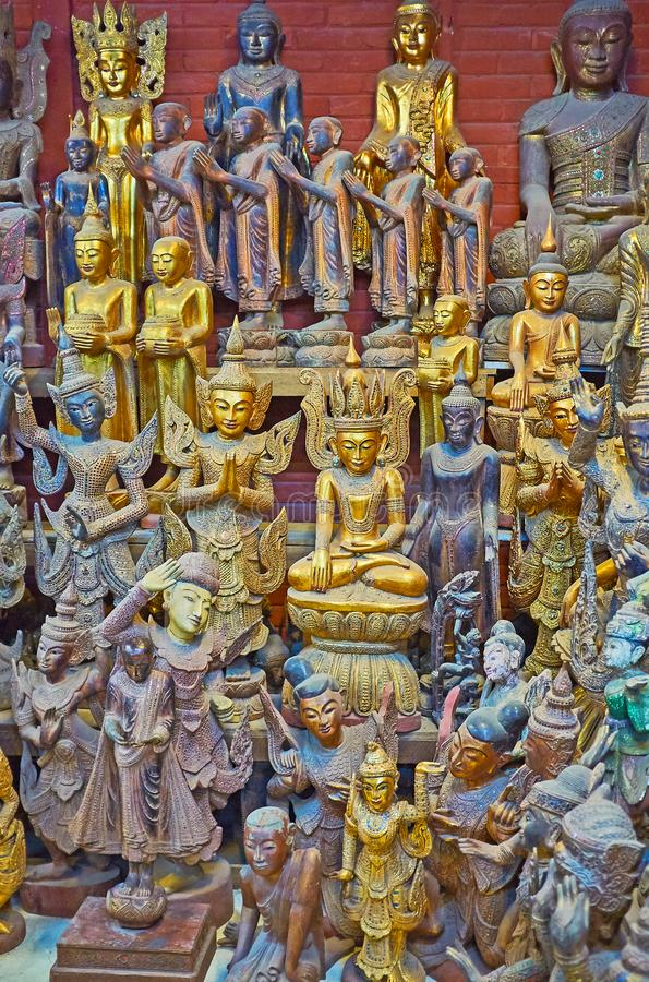 The wooden sculptures in store of Shwe-gui-do quarter, Mandalay, Myanmar. The ornate wooden sculptures of Buddha, his disciples, Nat deities and mythic creatures royalty free stock photos