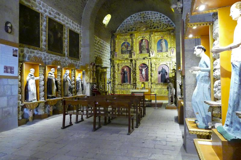 Ornately decorated gold shrine in the chapel of the Casa Real de la Moneda museum stock photo