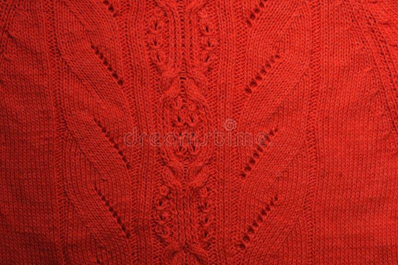 Ornements tricotés sur la texture de corail de tissu photo libre de droits