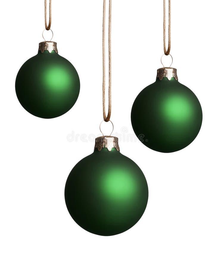 Ornements verts s'arrêtants de Noël photos libres de droits