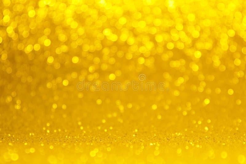 Oro, bokeh amarillo, fondo ligero abstracto del círculo, luces brillantes del oro rosado, la Navidad que brilla chispeante, luces foto de archivo libre de regalías