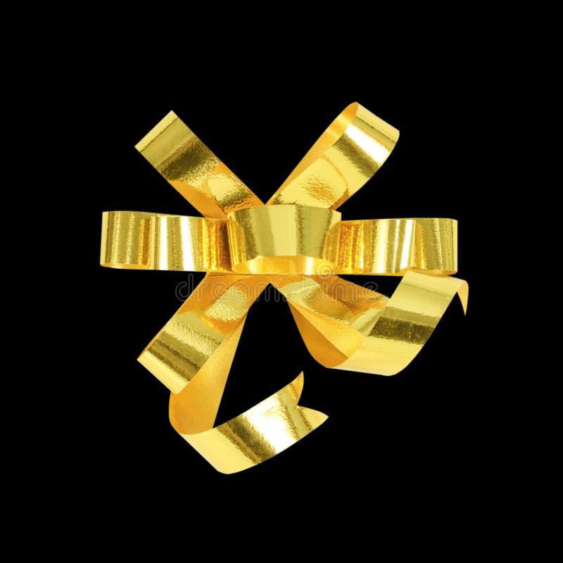 Oro decorativo & arco giallo del nastro di colore su fondo nero fotografie stock