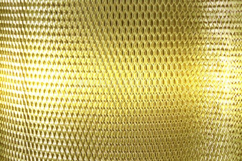Oro della griglia della maglia metallica fotografia stock libera da diritti