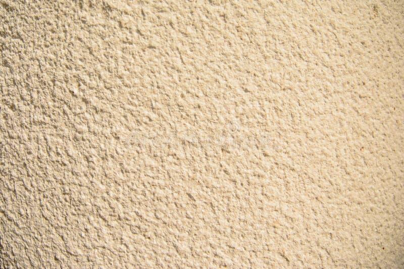 Oro di lerciume e dell'annata, crema o fondo beige di cemento naturale o di vecchia struttura di pietra, retro parete del modello fotografie stock libere da diritti
